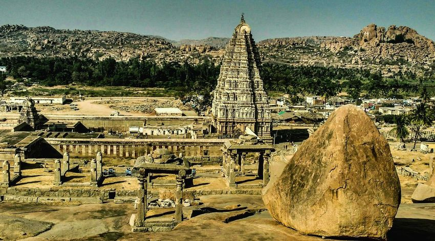 Hampi promises to take you back in time with it's unearthly landscapes and magnificent ruins. Vast Stretches of land with heaps of rocks and stones are bound to get you captivated. It's a page right out of the history book. Still wondering where the inspiration for Flintstones came from?? Go to Hampi. You will have a gay old time 😉 And who knows you might run into Fred and Wilma riding around. 😁😉 Yabba dabba doo!! Outdoors History Ancient The Great Outdoors - 2017 EyeEm Awards Mobilephotography Travelgram Mobilephonephotography Hampi. India Travel Destinations Indianphotography Eyemindia IndiaTravelDiaries Eyemphotography Incredible India Storiesofindia Travelog UNESCO World Heritage Site