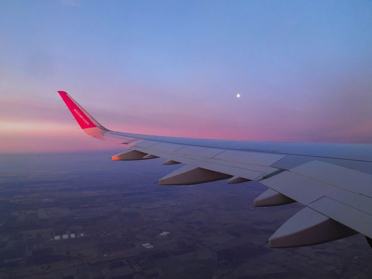 Aerial View Air Vehicle Aircraft Wing Airplane Airplane Wing Beauty In Nature Flying Mid-air Mode Of Transport Nature On The Move Pink Scenics Sky Sunrise Sunset Transportation Travel Wizzair