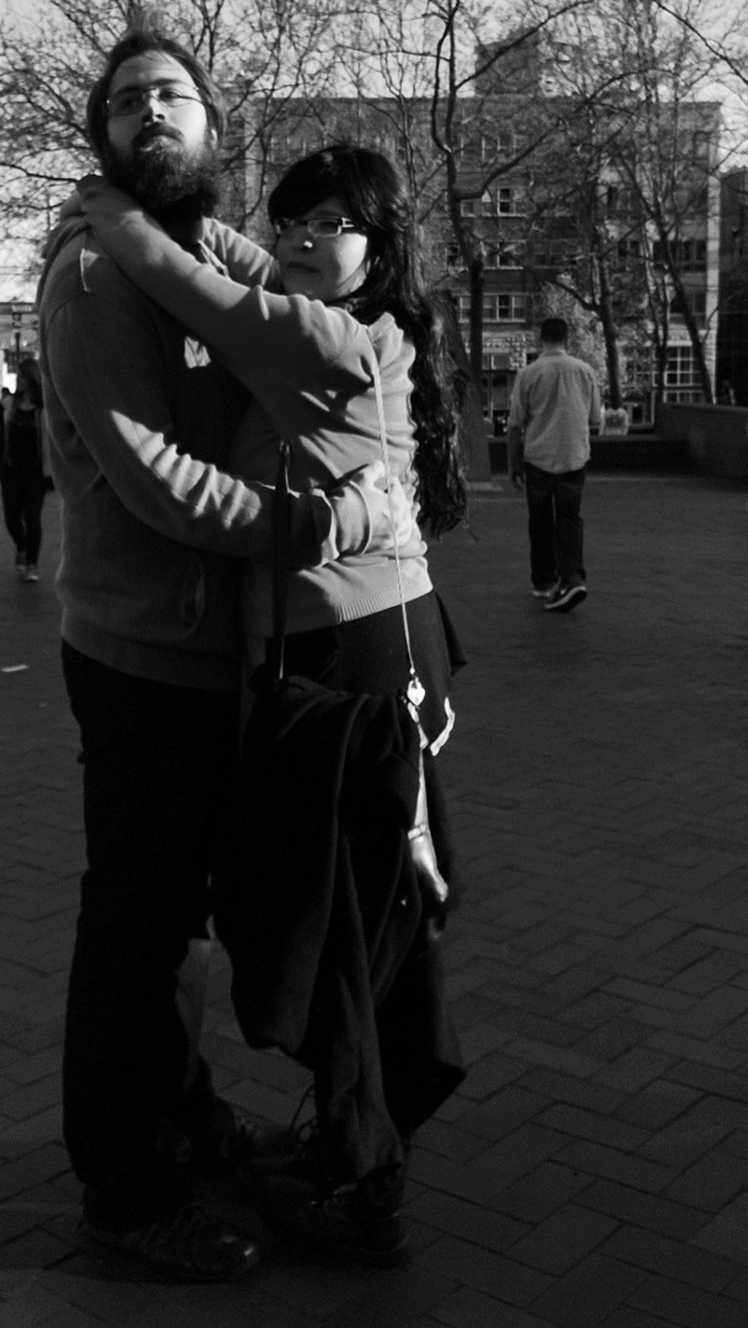 lifestyles, casual clothing, full length, leisure activity, togetherness, street, men, bonding, sitting, boys, person, childhood, rear view, walking, love, sidewalk, incidental people, outdoors