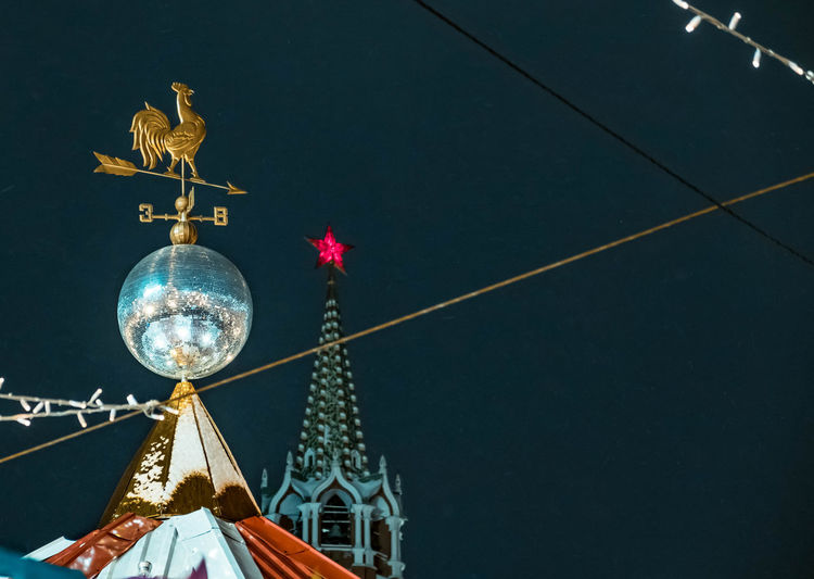 Low Angle View Of Weather Vane Against Sky At Night