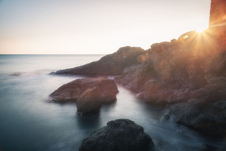 Framura Water Sky Beauty In Nature Scenics - Nature Rock Sea Rock - Object Tranquility Tranquil Scene Nature Sun Horizon Over Water Land No People Idyllic Sunbeam Sunset Liguria Italy Framura Long Exposure Sunlight Ray Rays Of Light Mediterranean