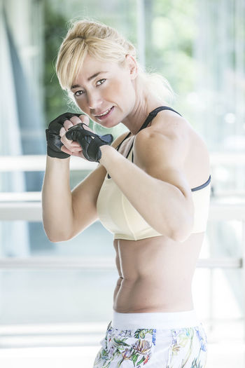 Portrait of muscular woman in fighting stance
