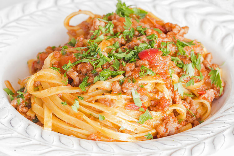 Close up of a plate of Tagliatelle with ragu sauce. Diet Dinner Dish Green Homemade Lunch Tagliatelle Bolognese Carbohydrate Close Up Fettuccine Food Health Indulgence Italian Italian Food Paesley Pasta Plate Sauce Temptation Tomato Traditional