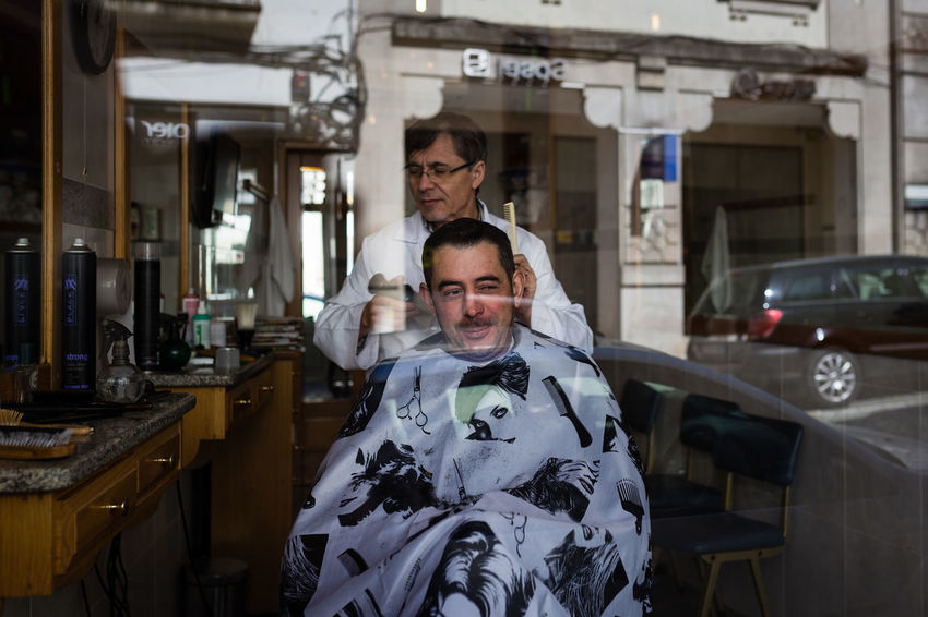At the hairdresser Barber Barberlife Barbershop Cutting Cutting Hair Gray Hair Hair Haircut Hairdresser Hairstyle Indoors  People Portrait Portugal Portuguese Reflection Shop Shop Window Smiling Srteet Streetphotography Two People
