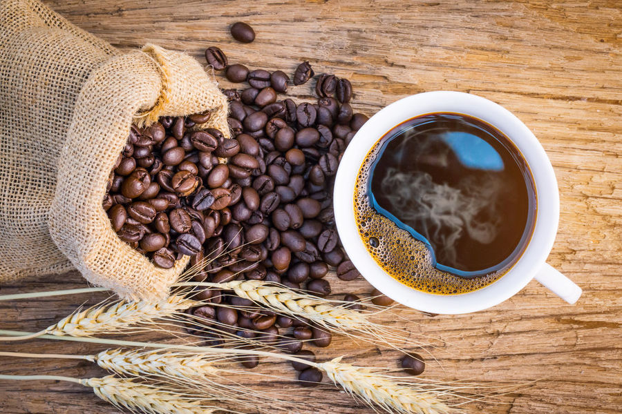 coffee bean,coffee cup on wooden table Bean Brown Close-up Coffee - Drink Coffee Bean Coffee Cup Drink Food Food And Drink Freshness Healthy Eating High Angle View Indoors  No People Sackcloth Still Life Table Wood - Material