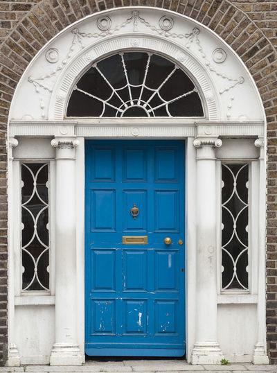 Closed door of blue building
