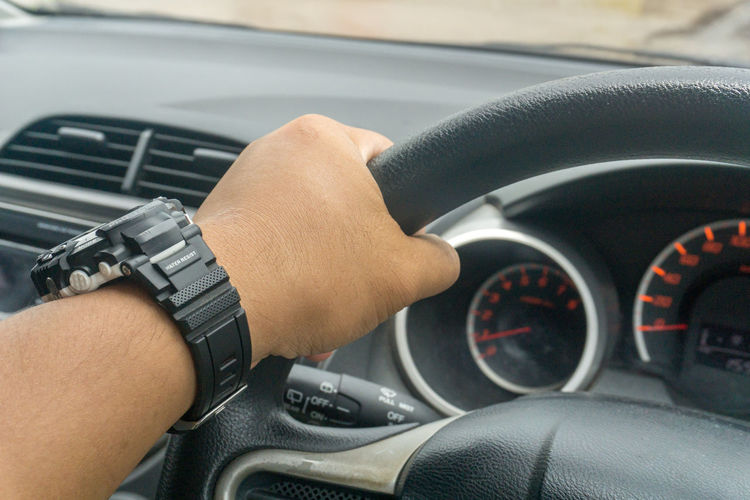 Car Car Interior Close-up Control Dashboard Day Driving Gauge Human Body Part Human Hand Land Vehicle Men Mode Of Transport One Person Outdoors Real People Speedometer Steering Wheel Transportation Vehicle Interior