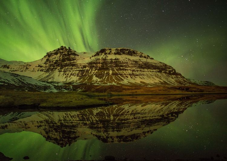 Northern lights, Iceland Aurora Dramatic Sky Northern Lights Astronomy Beauty In Nature Cold Temperature Lake Landscape Mountain Nature Night No People Outdoors Reflection Scenics Sky Snow Star - Space Stars Tranquil Scene Tranquility Water Winter