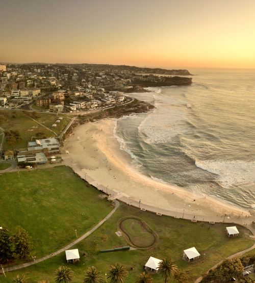 Bronte is a beachside suburb of Sydney, in the state of New South Wales, Australia. Bronte beach is located 7 kilometres east of the Sydney central business district, in the Waverley Council local government area of the Eastern Suburbs. Bronte Beach sits on Nelson Bay, surrounded by Bronte Park. Aerial View Architecture Beach Bronte Bronte Beach Building Exterior Built Structure City Cityscape Day Drone Photography Dronephotography High Angle View Horizon Horizon Over Water Land Nature No People Outdoors Sea Sky Sunset Travel Destinations Water