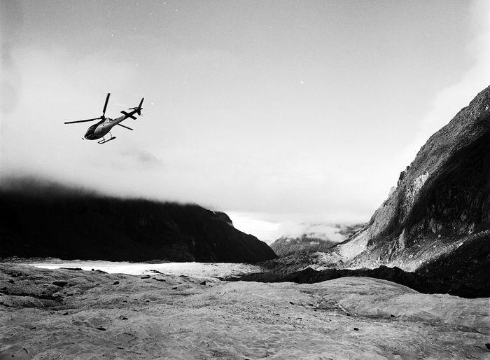 Helicopter leaves Fox Glacier. New Zealand Mamiya 645 Tri-X