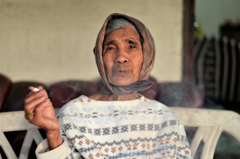 Portrait Of Senior Woman Smoking