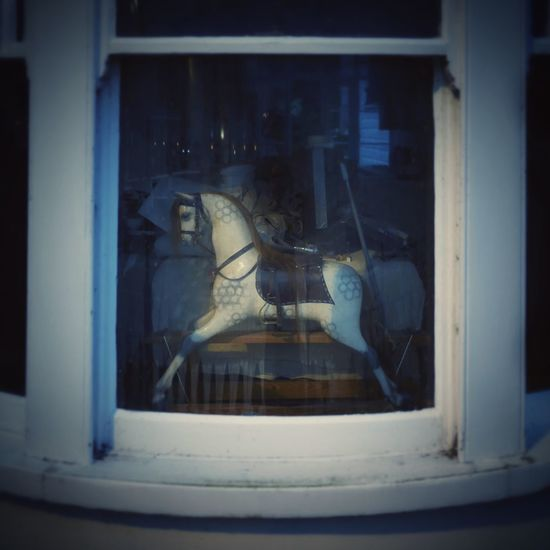 the Merry Go Round Horse Behind The Window in Weymouth Dorset England United Kingdom Bay Window Looking Through Window Night Night Photography Nightphotography Dream Global Photographer Works Exhibition Global Photographers Alliance Showcase June Fine Art Photography The Magic Mission Lieblingsteil Art Is Everywhere