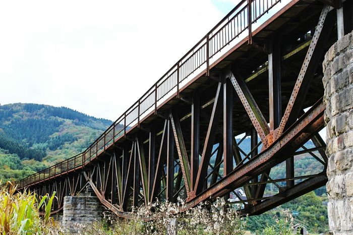 TakeoverContrast Bridge - Man Made Structure Architecture Bridge Built Structure Metal River Day Sky Mountain Outdoors Railway Bridge No People Countryside