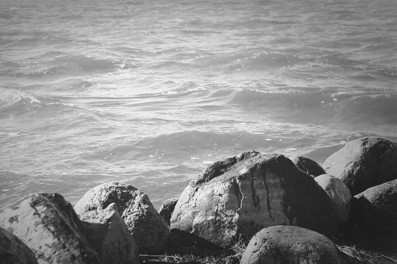 sea, water, nature, rock - object, beauty in nature, no people, outdoors, sunlight, wave, day, scenics, tranquility, beach, horizon over water, sky