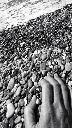 EyeEm Man Black And White Blackandwhite Photography Pebble Beach Water Low Section Sea Human Hand Beach Men Pebble Summer Shore Seaside Coastline Seashore Personal Perspective Coast Ocean