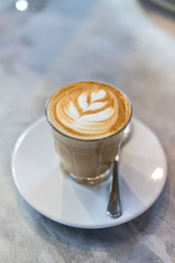 Coffee latte art Coffee Coffee - Drink Coffee Cup Drink Refreshment Food And Drink Mug Cup Cappuccino Saucer Frothy Drink Hot Drink Latte Crockery Eating Utensil Still Life Spoon Kitchen Utensil Table Froth Art No People Caffeine Glass