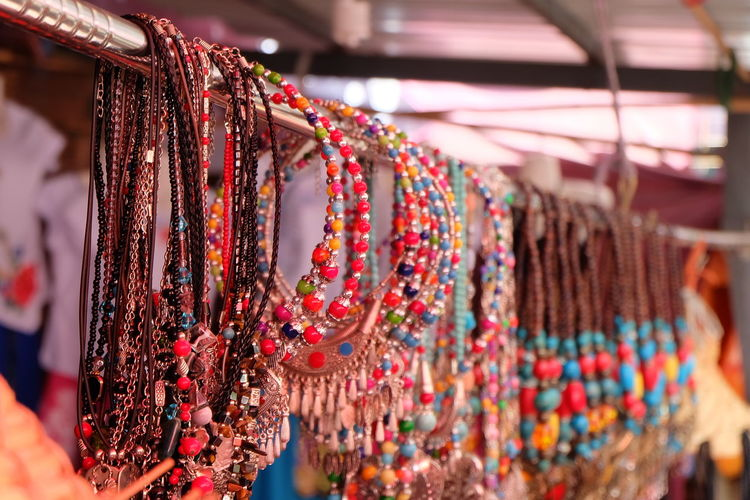 Close-up of bead necklaces hanging in store for sale