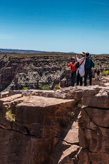 Beauty In Nature Canyon Casual Clothing Day Grand Canyon Leisure Activity Lifestyles Nature Outdoors Rock Formation Scenery Scenics Sky Spectacular View Sunlight Taking Pictures The Great Outdoors With Adobe The Week On EyeEm Tourism Tourist Tranquil Scene Tranquility Travel Destinations Vacations Vastness The Great Outdoors – 2016 EyeEm Awards