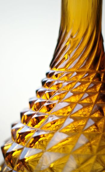 Gold Colored Textured  Glass Bottle Close-up Studio Shot Indoors  No People Yellow Glass Bottle Pattern Texture Textured Glass Decorative Glassware Warm Colors Ornament Macro Close Up Golden Glass