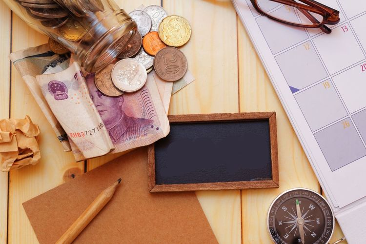 Travel,exploration,financial concept Compass Wooden Background Pencil Glass Jar Money Financial Finance Concept Conceptual Blank Copy Space Copyspace Money Money Money Money Calendar Table Directly Above High Angle View Close-up Personal Organizer To Do List