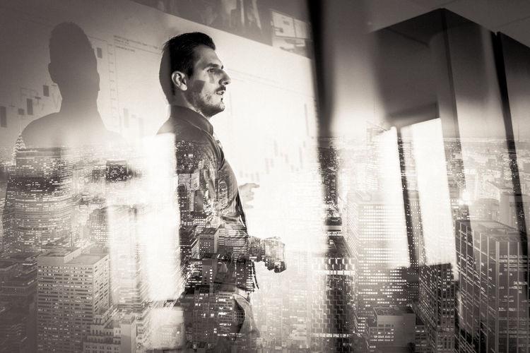 Digital composite image of man standing in rain