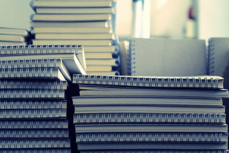 Close-up of stacked books on table