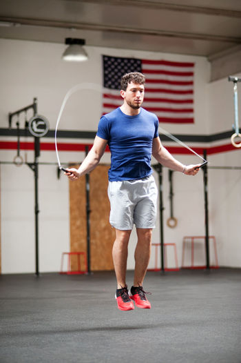 Fit athletic young man using a skipping rope Sport Full Length Healthy Lifestyle Lifestyles One Person Exercising Leisure Activity Sports Clothing Sportsman Physical Activity Athlete Skipping Rope Agility Workout Crossfit Fitness Gym Muscular Toning Training
