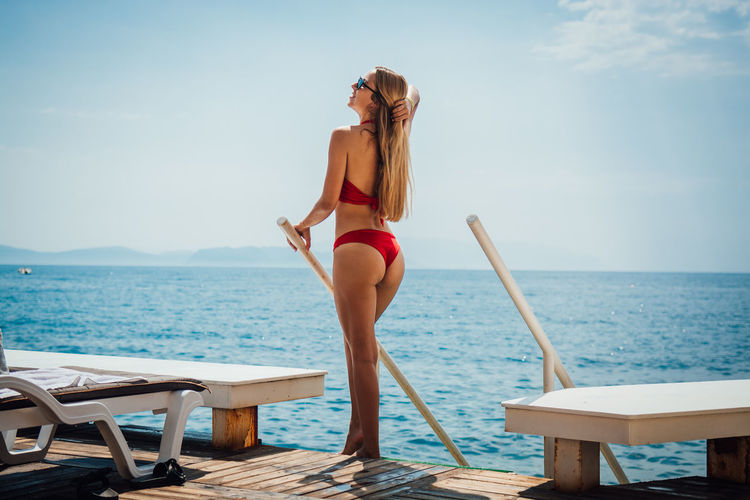Water Sea Young Adult Sky Young Women One Person Clothing Swimwear Lifestyles Chair Beauty In Nature Women Leisure Activity Adult Horizon Full Length Real People Bikini Beautiful Woman Horizon Over Water Hairstyle