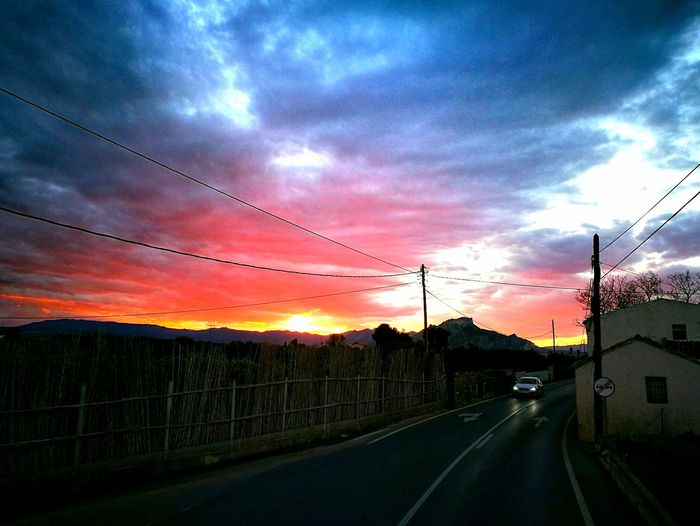 Sunset Dramatic Sky Sky Dusk Nature Rural Scene Road Transportation No People Idyllic Cloud - Sky The Way Forward Beauty In Nature Scenics Tree Outdoors Wet Agriculture Landscape Motion The City Light