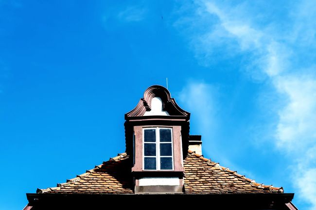 Low angle view of building against blue sky. EyeEm Selects Roof Sky Architecture Building Exterior Built Structure