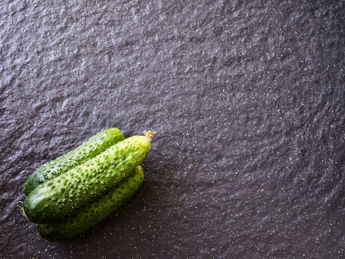 High angle view of cucumbers on slate
