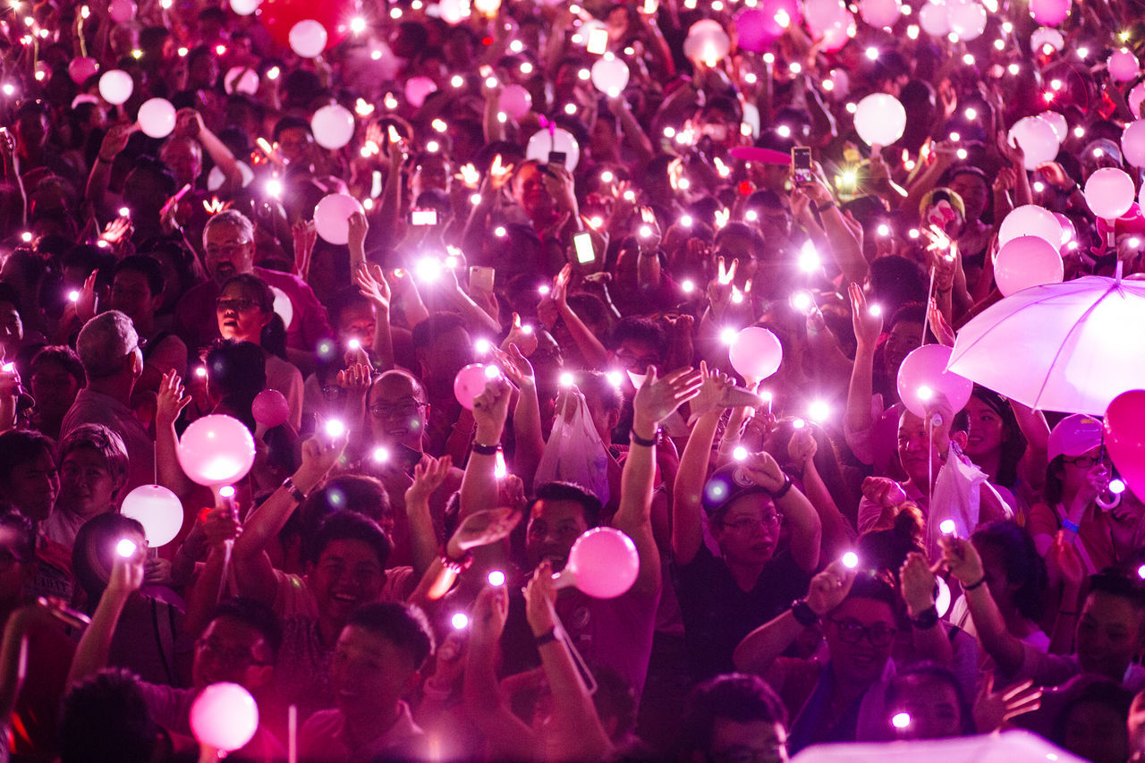 large group of people, night, crowd, real people, celebration, togetherness, enjoyment, men, women, illuminated, fun, leisure activity, outdoors, nightlife, lifestyles, multi colored, popular music concert, adult, people, adults only