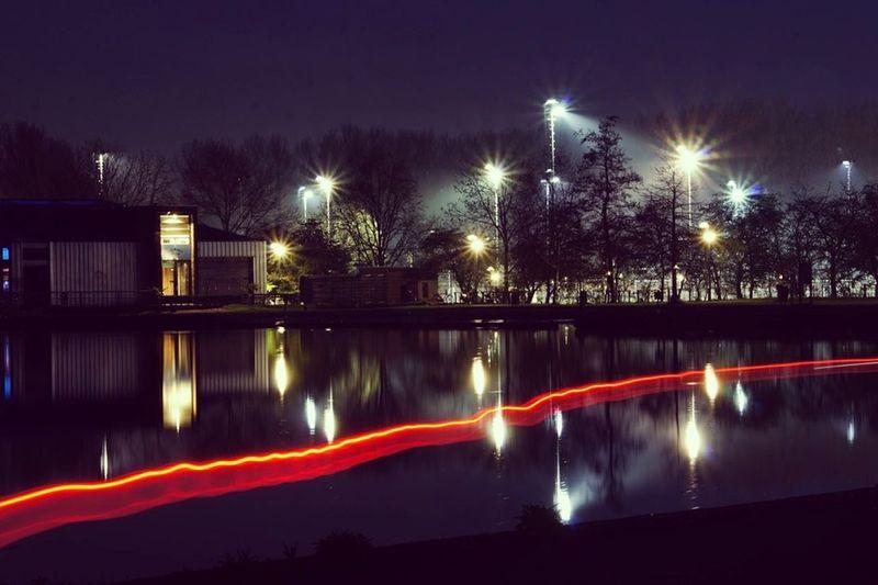 Night Illuminated ReflectionOutdoors Water Passing Bike Long Exposure City