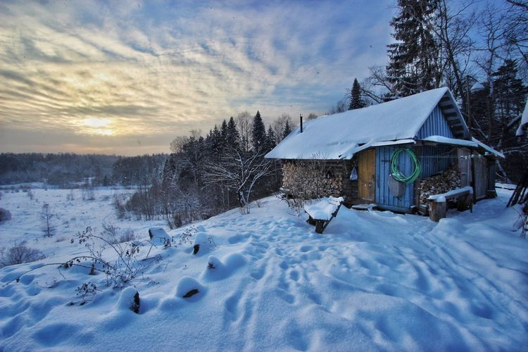 Snow Covered House And Landscape At Sunset