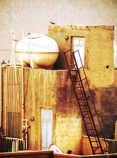 Water tank Rooftop Built Structure Architecture Building Exterior No People Outdoors Day Low Angle View rust Ladder To Water EyeEmNewHere