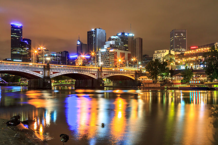 Princes Bridge with the Yarra River and CBD in the background Arch Bridge Architecture Bridge Bridge - Man Made Structure Building Building Exterior Built Structure City Cityscape Connection Illuminated Light Nature Night No People Office Building Exterior Outdoors Reflection River Sky Skyscraper Street Transportation Water Waterfront