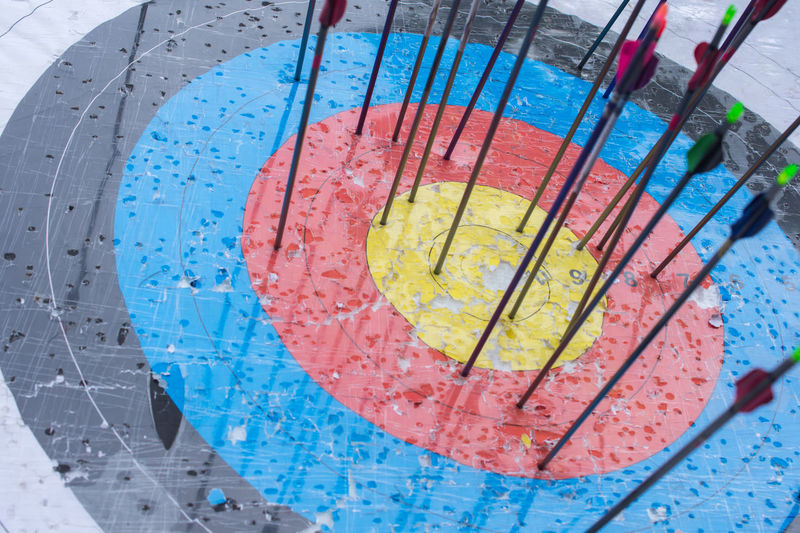 Archery target with arrows on it. Success concept Analyzing Backgrounds Blue Close-up Education Glass - Material Healthcare And Medicine High Angle View Indoors  Laboratory Medical Research Multi Colored No People Petri Dish Pink Color Research Science Scientific Experiment Technology Transparent