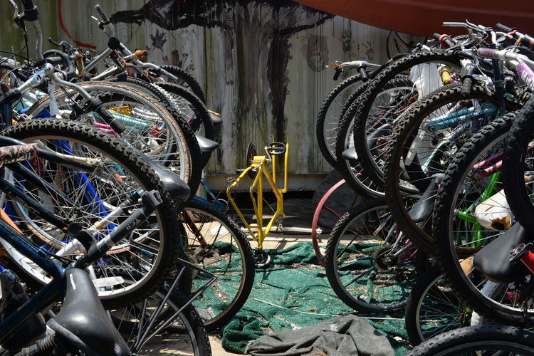 Bicycles At Parking Lot In City