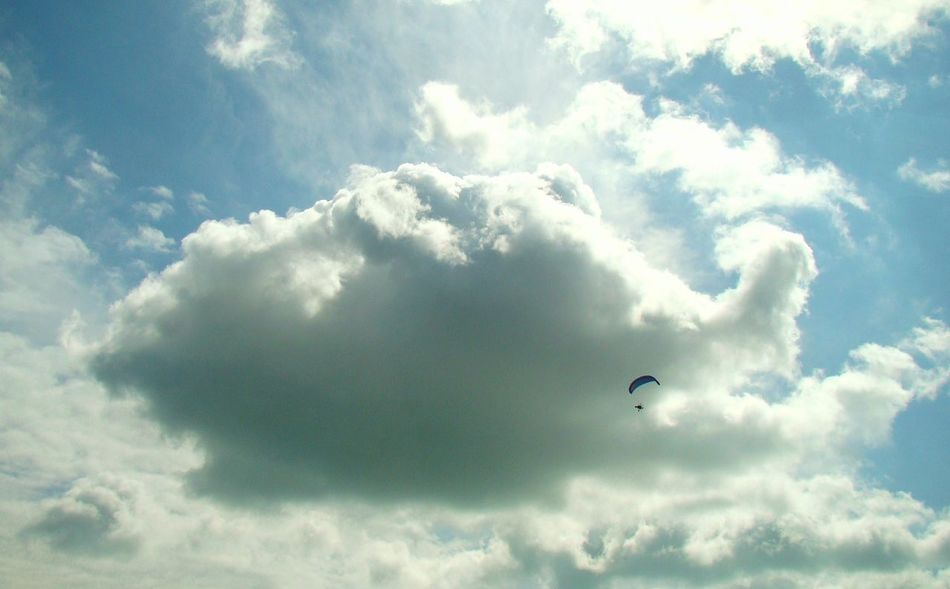 The Sky Is The Limit Adventure Beauty In Nature Cloud - Sky Day Extreme Sports Flying Freedom Leisure Activity Low Angle View Mid-air Nature Outdoors Paragliding Sky Sport