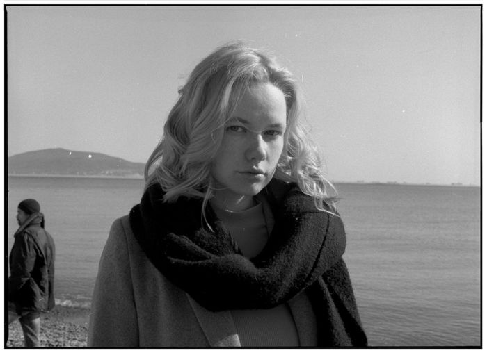 A series of black and white photos on the beach in a winter sunny day. Shooting by the sea. Portraits with natural light. Candid Authentic Moments Authentic Lifestyle Blackandwhite Real People Sea Portrait Sky Water One Person Leisure Activity Young Women Hair Looking At Camera Women Standing Young Adult Headshot Hairstyle Contemplation Horizon Over Water Warm Clothing Beautiful Woman Scarf