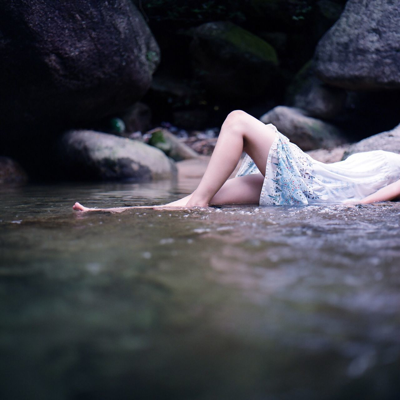 Low Section Of Woman Lying In Water