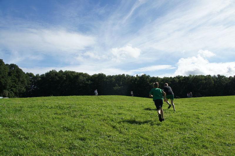 Man on golf course on field against sky