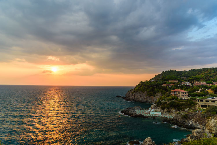 Beauty In Nature Building Exterior Cliff Cloud - Sky Cloudy Coastline Dramatic Sky Horizon Over Water Idyllic Nature No People Non-urban Scene Ocean Outdoors Scenics Sea Seascape Shore Sky Sun Sunset Tranquil Scene Tranquility Water Waterfront