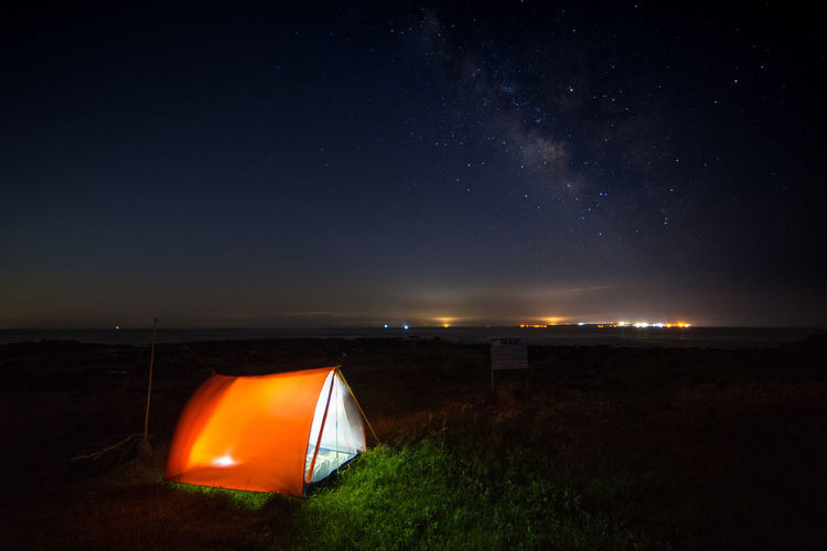Adventure Astronomy Beauty In Nature Camping Field Galaxy Grass Illuminated Landscape Milkyway Nature Night Nightphotography No People Orange Color Outdoors Scenics Shelter Sky Star - Space Tent Tranquil Scene Tranquility The Great Outdoors - 2017 EyeEm Awards Fresh On Market 2017