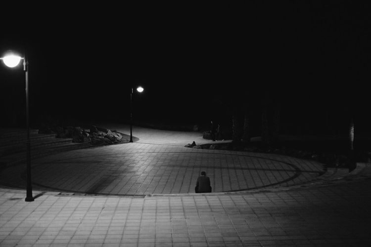 Empty footpath in city at night