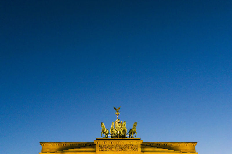 Brandenburg Gate at sunset Berlin Brandenburg Gate Germany 🇩🇪 Deutschland Quadriga Architecture Art And Craft Blue Building Exterior Built Structure City Clear Sky Color Image Copy Space Day History Human Representation Low Angle View Monument No People Outdoors Sculpture Sky Statue Travel Destinations