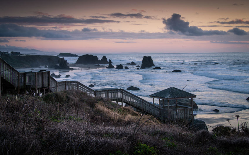 Stairs going down to the beach in bandon, oregon. moody winter photo