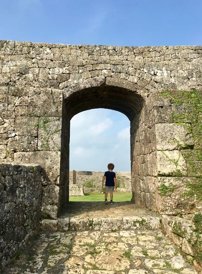 Boy at Nakagusuku castle entry way Castle Nakagusuku Child Boy Adventure Architecture Real People Sky Built Structure Arch Lifestyles Full Length Day Leisure Activity Nature History One Person The Past Rear View Standing Women Wall Sunlight Outdoors