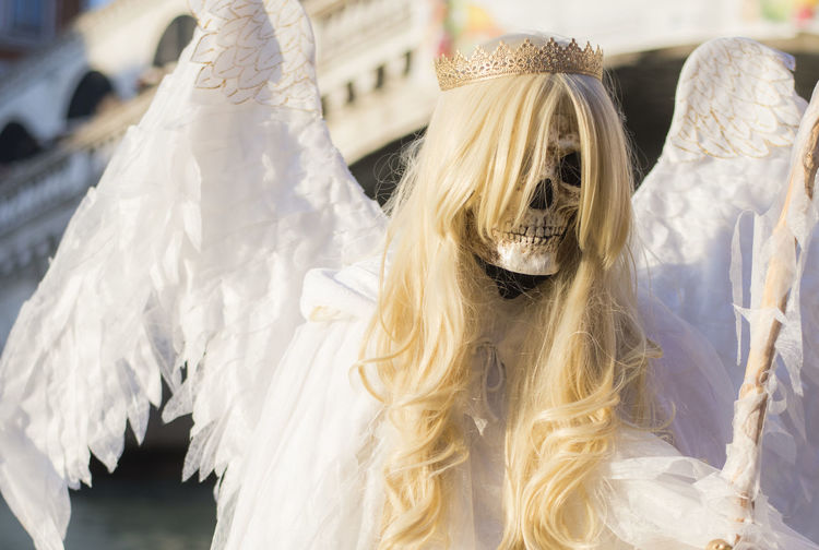 Close-up of skeleton in angel costume