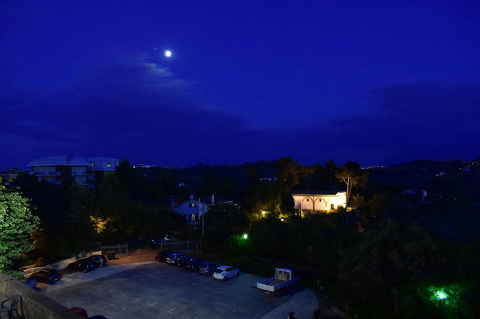 Architecture Blue Building Building Exterior Built Structure City Dusk House Illuminated Lighting Equipment Moon Moonlight Nature Night No People Outdoors Plant Residential District Sky Street Tree